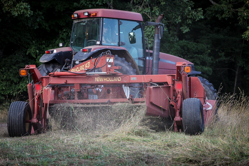 A pre festival view of the  farmer cutting the fields. (Howard Pitkow/for Newsworks)