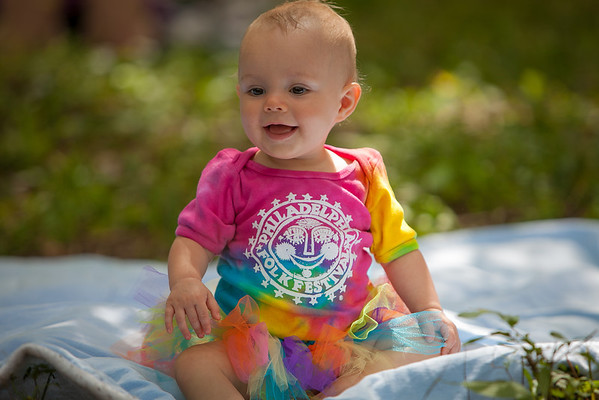Baby Amilia wearing festival bought tie dyed clothing. (Howard Pitkow/for Newsworks)