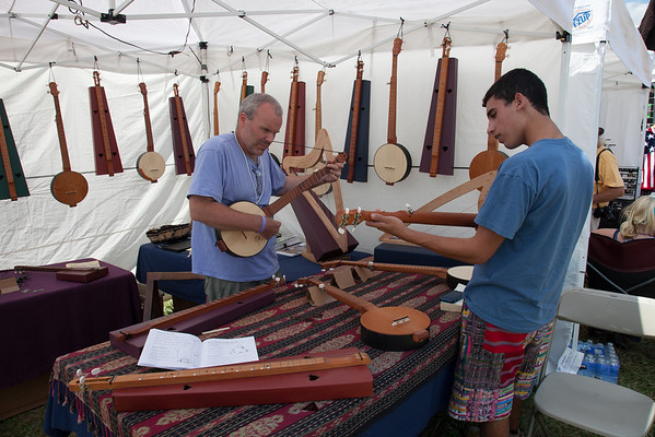 Handmade instruments being tried out before buying. (Howard Pitkow/for Newsworks)