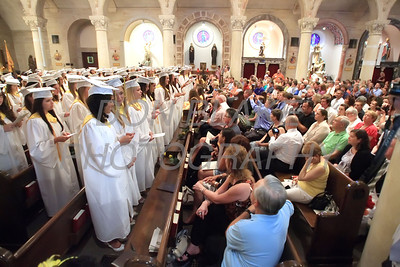 Padua Graduates sing to their parents during the commencement ceremony at St. Anthony of Padua Church, Thursday, May 31, 2012. Courtesy of Padua Academy-photo/Don Blake Photography
