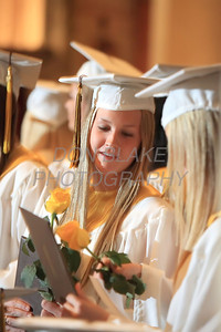 Padua Graduates check out their diplomas during the commencement ceremony at St. Anthony of Padua Church, Thursday, May 31, 2012. Courtesy of Padua Academy-photo/Don Blake Photography