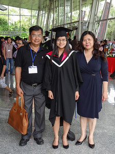 Quynh with her parents, Que and Phi.