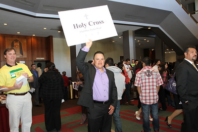 Juan Carlos Gallardo holds up a sign to draw the attention of his church parishioners.