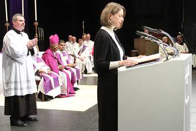 Robin Kirk of St. Brigid Church, Johns Creek, reads the names of the nine catechumens from her North Fulton County parish.