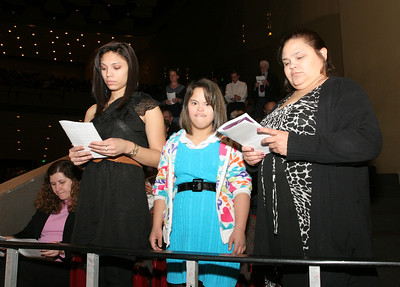 (L-r) Catechumens Mary and Nayomi Caraballo of St. George Church, Newnan, stand with their mother Carmen Oponte.