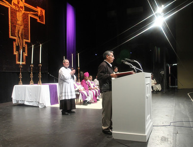 Bonifacio Velasquez of St. Bernadette Church, Cedartown, reads off the names of the 21 catechumens from his parish.