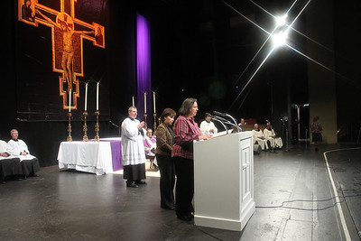 The Cathedral of Christ the King's Teresa Vigil and Aida Buzeta read the names of the catechumens from their parish.