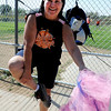"Shelia Cimafranca puts on her ""umpire tutu"" at a benefit softball tournament at Stazio Fields on Sunday.<br /> Izzy Crouse started a softball tournament to raise money to help fight breast cancer after her teammate, Heidi Muller contracted the disease.<br /> For a video and more photos of the softball, go to  <a href=""http://www.dailycamera.com"">http://www.dailycamera.com</a>.<br /> Cliff Grassmick  / August 12, 2012"