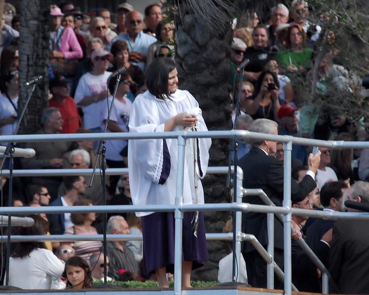 Anna Athanasatos of Tarpon Springs, FL. will release the dove.