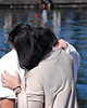 Alexi is comforted by his Mom, Eleftheria Lake. He was later recognized and honored for retrieving the Cross in a historic Epiphany event.
