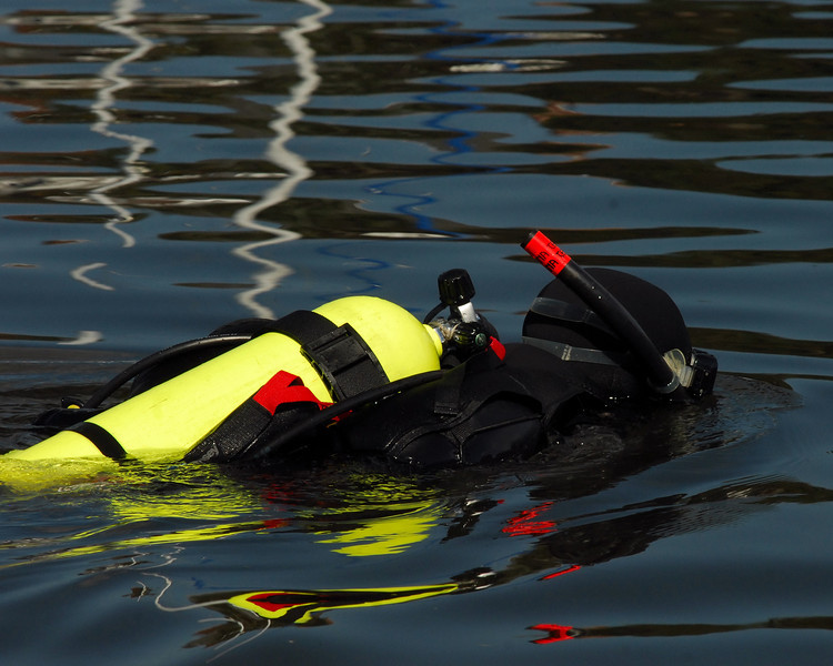 The rescue divers check the water and get into position.