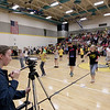 Record-Eagle/Keith King<br /> Emma Simon, 14, uses a video camera as students cheer and dance for the school's lip dub video Wednesday, May 9, 2012 at Traverse City East Middle School. Jody Mackey organized the video with her broadcast journalism students, along with other students in the school, contributing in a variety of ways. The video is expected to be posted to the school's website next week.