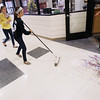 Record-Eagle/Keith King<br /> Megan Puckett, right, and Emily Decker, both 14, clean up confetti and aerosol string Wednesday, May 9, 2012 that was used during the recording of a lip dub video at Traverse City East Middle School.  Jody Mackey organized the video with her broadcast journalism students, along with other students in the school, contributing in a variety of ways. The video is expected to be posted to the school's website next week.