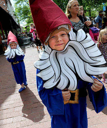 """Blake Niemann, right, and his little brother, Grant, back left, were among the elves in the parade on Saturday.<br /> Downtown Boulder held the popular Tulip Fairy and Elf Parade on the Pearl Street Mall on Saturday.<br /> For  a video and more photos of the event, go to  <a href=""""http://www.dailycamera.com"""">http://www.dailycamera.com</a><br /> Cliff Grassmick / April 28, 2012"""