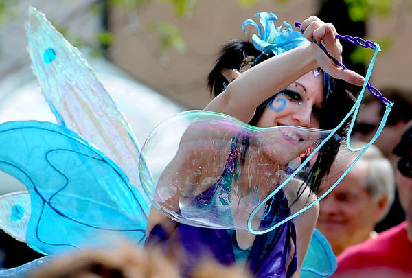 "Elana McMaster,  Lily the Blue Fairy, makes giant bubbles for the elves and fairies below.<br /> Downtown Boulder held the popular Tulip Fairy and Elf Parade on the Pearl Street Mall on Saturday.<br /> For  a video and more photos of the event, go to  <a href=""http://www.dailycamera.com"">http://www.dailycamera.com</a><br /> Cliff Grassmick / April 28, 2012"