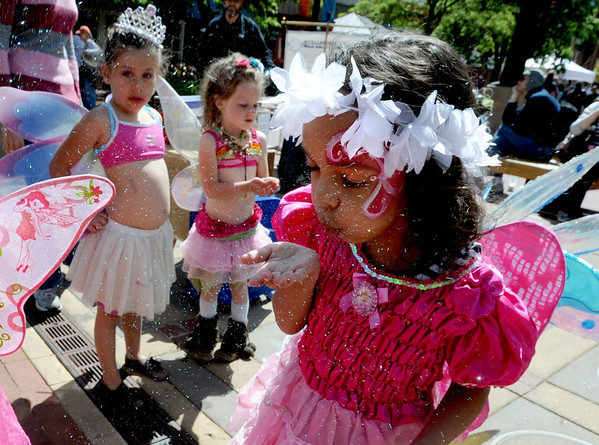 "Isabella Padilla, 5, blows her fairy dust for good luck before the parade.<br /> Downtown Boulder held the popular Tulip Fairy and Elf Parade on the Pearl Street Mall on Saturday.<br /> For  a video and more photos of the event, go to  <a href=""http://www.dailycamera.com"">http://www.dailycamera.com</a><br /> Cliff Grassmick / April 28, 2012"