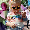 "Penelope Bodnar, 2, tries to get the bubbles to come out before the parade.<br /> Downtown Boulder held the popular Tulip Fairy and Elf Parade on the Pearl Street Mall on Saturday.<br /> For  a video and more photos of the event, go to  <a href=""http://www.dailycamera.com"">http://www.dailycamera.com</a><br /> Cliff Grassmick / April 28, 2012"