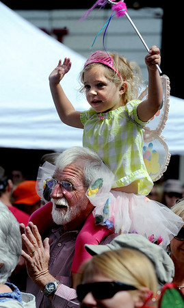 """Jim Schubert of Boulder, puts his granddaughter on his shoulders so she can see the show.<br /> Downtown Boulder held the popular Tulip Fairy and Elf Parade on the Pearl Street Mall on Saturday.<br /> For  a video and more photos of the event, go to  <a href=""""http://www.dailycamera.com"""">http://www.dailycamera.com</a><br /> Cliff Grassmick / April 28, 2012"""