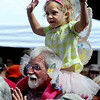 "Jim Schubert of Boulder, puts his granddaughter on his shoulders so she can see the show.<br /> Downtown Boulder held the popular Tulip Fairy and Elf Parade on the Pearl Street Mall on Saturday.<br /> For  a video and more photos of the event, go to  <a href=""http://www.dailycamera.com"">http://www.dailycamera.com</a><br /> Cliff Grassmick / April 28, 2012"