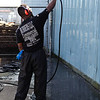Bubber's LLC pressure washes a White Center building.