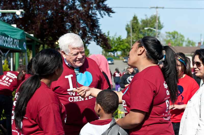 Jim McDermott visits with volunteers at the White Center Spring Clean
