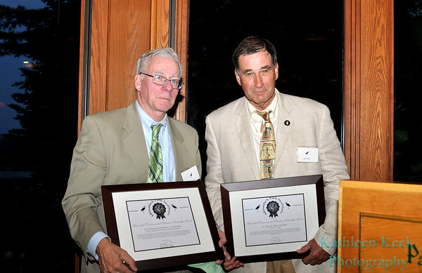 SUNY ESF President Neil Murphy and Paul Smith's College President John Mills accepting their leadership awards.