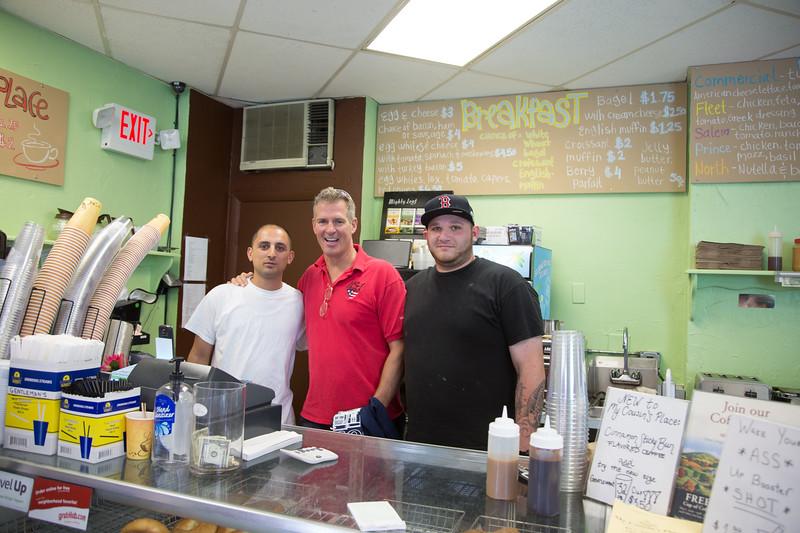 U.S. Senator Scott Brown (center) behind the counter of My Cousins Place with North End cousins Daniel D'Elia (left) and Ralph Verrocchi