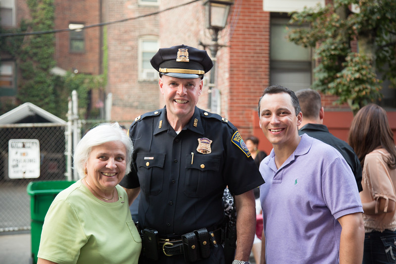 Boston Police District A-1 Captain Tom Lee with State Rep. Aaron Michlewitz and Francine Gannon.