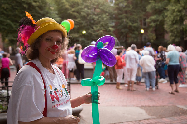 Crystals the Clown keeps the kids happy with balloon animals.