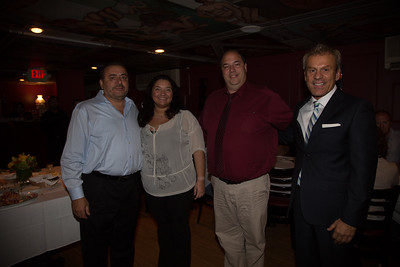 North End Against Drugs Board Members Rosia Fabbo and John Romano accept donation from Taste of the North End co-chairs, Donato Frattaroli and Jim Luisi