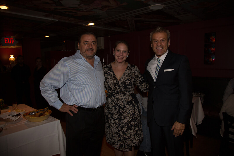 NEMPAC's Executive Director Rebecca Griffin accepts donation from Taste of the North End co-chairs, Donato Frattaroli and Jim Luisi