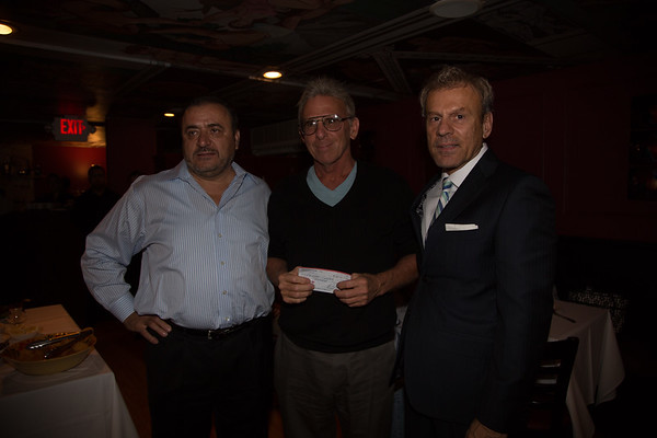 Carl Ameno (center) of the Nazzaro Center accepts donation from Taste of the North End co-chairs, Donato Frattaroli and Jim Luisi