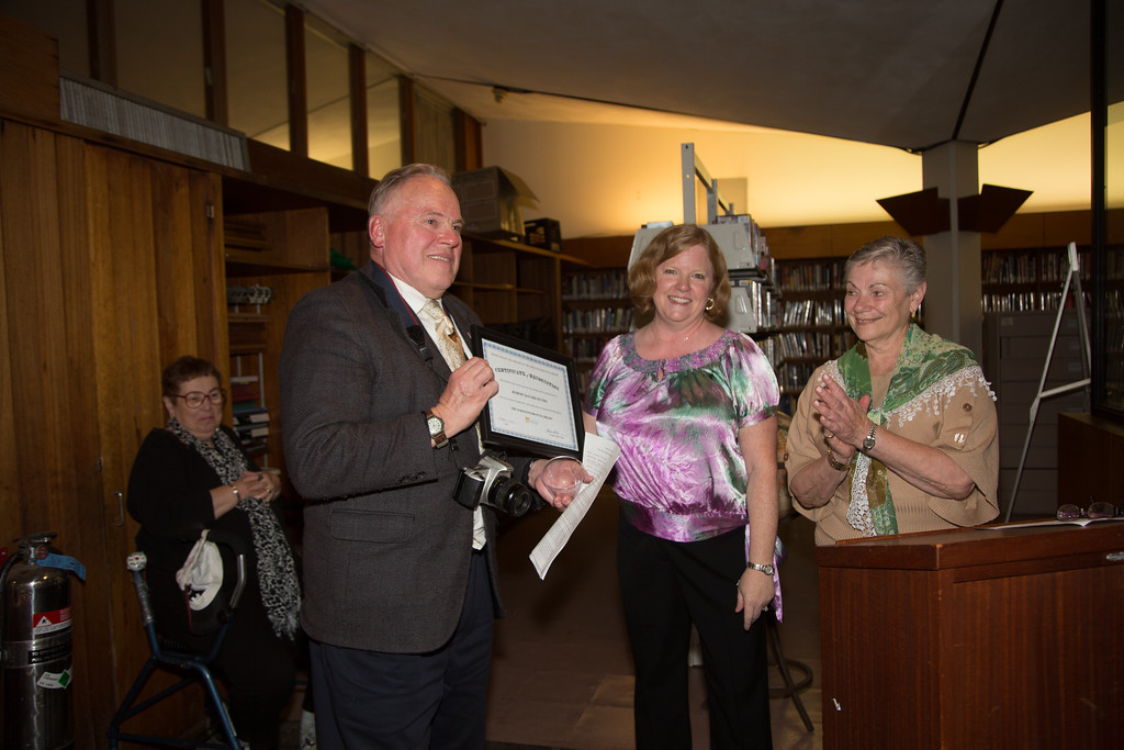 Robert Severy is presented an award from Friends President Robin Ardito and Officer Phyllis Vitti