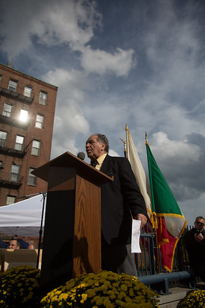 Tony DeMarco speaks at the unveiling ceremony at the corner of Hanover and Cross Streets