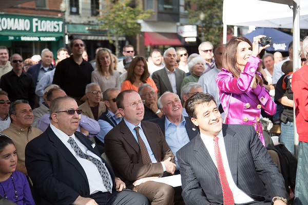 Consul General of Italy, Guiseppe Pastorelli (brown jacket) with Privitera family members in the audience