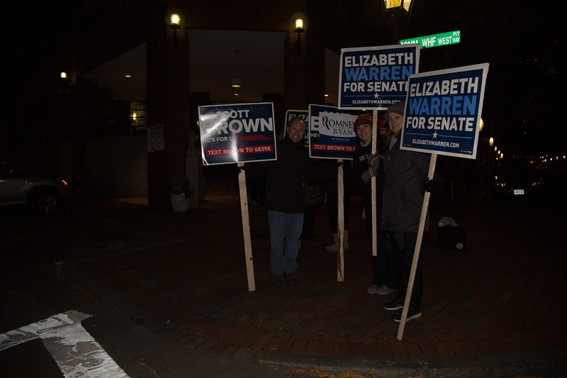 Chilly sign holders outside the poll at 145 Commercial Street - Christopher Columbus Housing (Photo by Matt Conti)