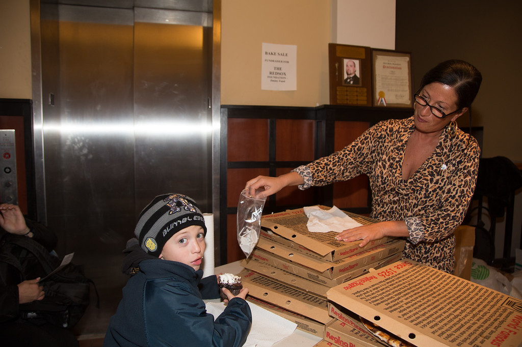 Enjoying the pizza and sweets at the Nazzaro Center Bake Sale (Photo by Matt Conti)