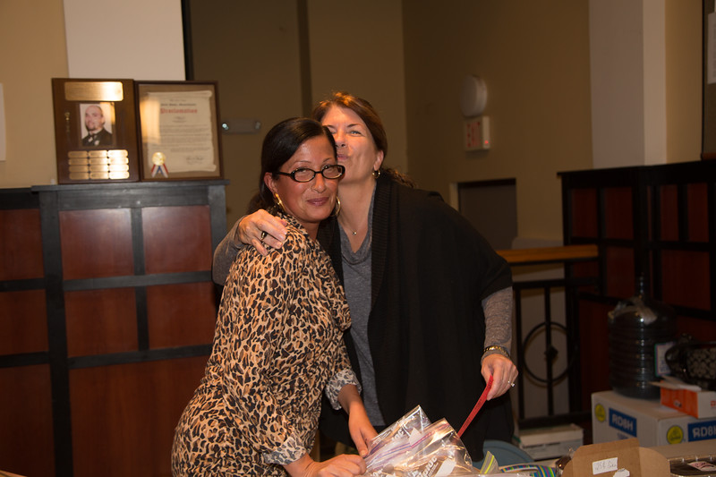 Lots of love and a little silliness after a long Election Day at the Nazzaro Center Bake Sale (Photo by Matt Conti)