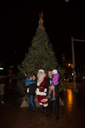 The McGivern's in front of the Cross St Christmas Tree