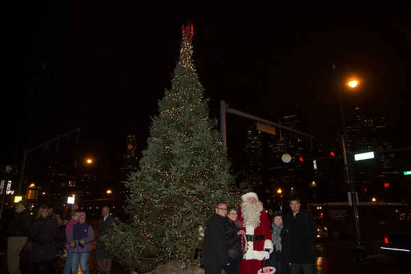 City Councilor Sal LaMattina (left) and Santa with the NE Beautification Committee, Patricia, Alison and David