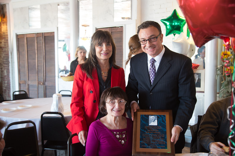Kathy Carangelo (standing), Mrs. Carangel and Councilor Sal LaMattina with the Ferdinand Carangelo Humanitarian Award