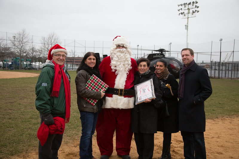 Pallotta Family with Santa who arrived by helicopter.