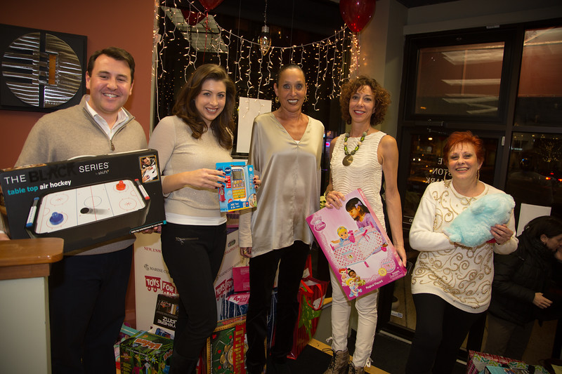 The team at Elite Boston Landmark putting on the Toys for Tots event