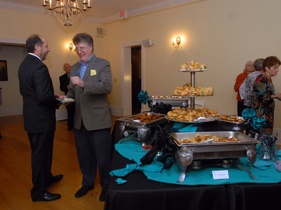 """Elmhurst Heritage Foundation Board member Mike LoCicero and Foundation President Gene Evans attend the """"Meet Me At The Fair"""" wine and beer tasting held at Wilder Mansion through the Elmhurst Heritage Foundation Thursday October 25, 2012.  Staff photo by Erica Benson"""