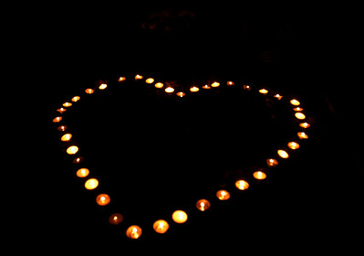 Candles in the shape of a heart at Sacajawea Park during the candlelight vigil for the one year anniversary of the death of Kelli O'Laughlin Saturday October 27, 2012.  Staff photo by Erica Benson   |    Buy this photo at snapshots.mysuburbanlife.com/1558117