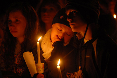 Lyons Township students (left-right) Bess Connelly, Victory Lampert and Danny Thuma gather for a candlelight vigil for the one year anniversary of the death of Kelli O'Laughlin at Sacajawea Park Saturday October 27, 2012.  Staff photo by Erica Benson   |    Buy this photo at snapshots.mysuburbanlife.com/1558117