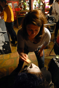 Selina Valazquez of Cicero gets her face painted by Melissa Moore of Forest Park prior to the Zombie Walk and Pub Crawl sponsored by Horrobles in Berwyn Saturday October 27, 2012.  Makeup artists paint participants faces for the event.   Staff photo by Erica Benson   |    Buy this photo at snapshots.mysuburbanlife.com/1558190