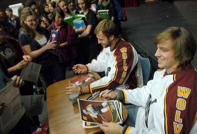 Chicago Wolves Hockey players (left) Yann Sauve and Alexandre Mallet sign their autographs for  Glenbard North French students after a Q & A Tuesday October 30, 2012.  Staff photo by Erica Benson