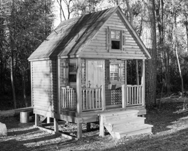 The playscape at Herman Little Park offers a child-sized log cabin.