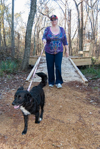 Jeanette Knepp and Lucky visit the wetlands observation deck on a recent visit to Herman Little Park.
